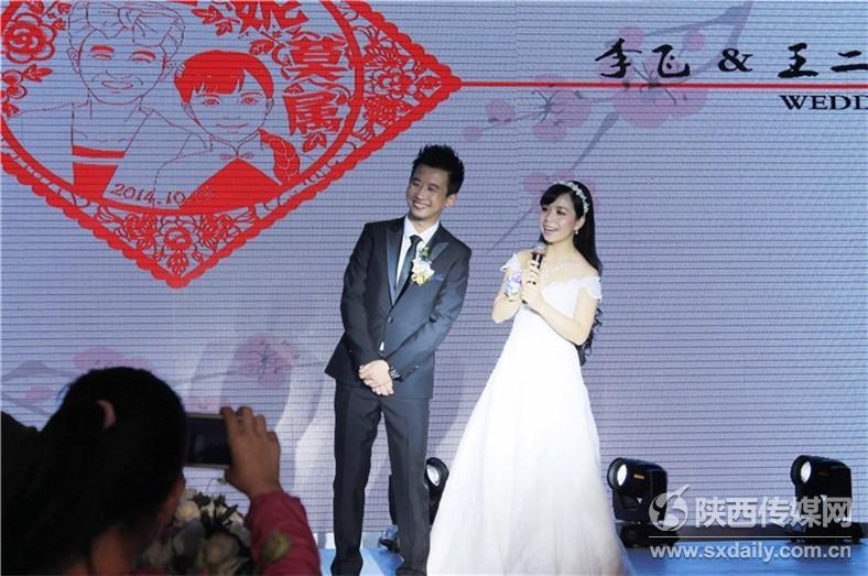王二妮的丈夫_王二妮老公李飞简历和结婚照,王二妮演唱会视频,王二妮全部 ...